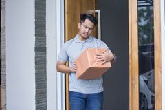 Man recieve a delivery box. At home Stock Image