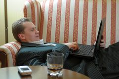 Man reclining with laptop Royalty Free Stock Photos