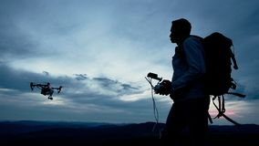 Hiker controlling quadcopter using smartphone
