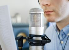 Man recording an advertisement. Man recording an advertisement on the radio station Royalty Free Stock Image