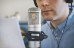 Man recording an advertisement. Man recording an advertisement on the radio station Royalty Free Stock Photos