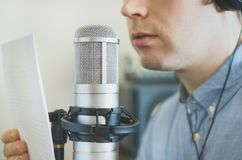 Man recording an advertisement. Man recording an advertisement on the radio station Stock Photos