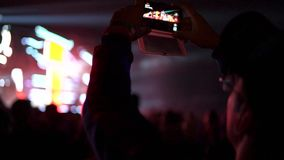 Man recording a gig in phone stock footage