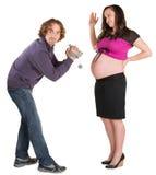 Man Recording Pregnant Woman Stock Photos