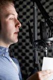 Man In Recording Studio Talking Into Microphone Stock Photography
