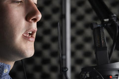 Man In Recording Studio Talking Into Microphone. Close Up Of Man In Recording Studio Talking Into Microphone Royalty Free Stock Photo