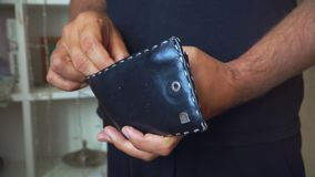 Man recounts money in wallet. hands of a man close up. stock footage