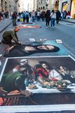 Man recreates famous paintings in chalk on the street in Florenc. Florence, Italy - Apr 23, 2017: Man recreates famous paintings in chalk on the street Royalty Free Stock Photo
