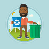 Man with recycle bin and trash can. Royalty Free Stock Photography