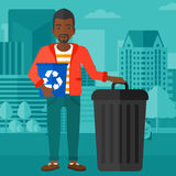 Man with recycle bins. Stock Image