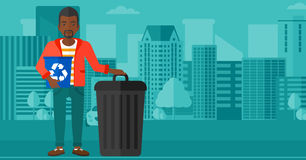 Man with recycle bins. Royalty Free Stock Photos