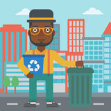 Man with recycle bins. Stock Photo