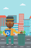 Man with recycle bins. Royalty Free Stock Photo