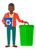 Man with recycle bins Royalty Free Stock Photo