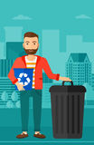 Man with recycle bins. Royalty Free Stock Photography