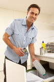 Man Recyling Waste At Home Stock Photos