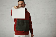 Man in red anorak with white sheet of paper Royalty Free Stock Photography