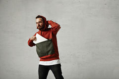 Man in red anorak with white sheet of paper Stock Image