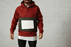 Man in red anorak with white sheet of paper Stock Photos