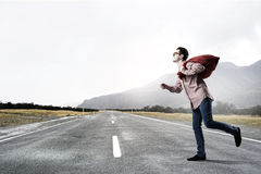 Man with red bag Royalty Free Stock Images