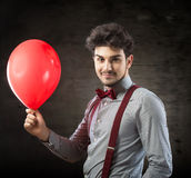 Man with a red balloon Royalty Free Stock Image