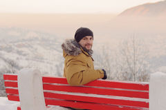 Man on Red Bench Stock Photography