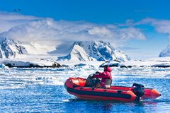 Man in the red boat. In Antarctic waters stock images