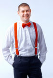 Man with red bow tie and brases Stock Images