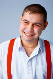 Man With Red Brases. Picture of a happy young man with red braces Stock Image