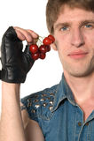 Man with red cherries Stock Photo