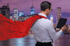 The man in red cover protecting city Stock Images