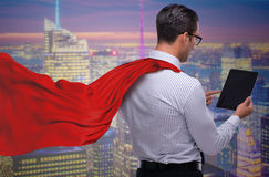 The man in red cover protecting city Royalty Free Stock Photos