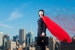 The man in red cover with skyscapers at the background Stock Images