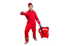 Man in red coveralls. With shopping supermarket cart trolley Royalty Free Stock Photography