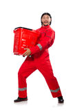 Man in red coveralls with shopping supermarket. Cart trolley Stock Photos