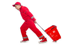 Man in red coveralls with shopping supermarket. Cart trolley Stock Photography