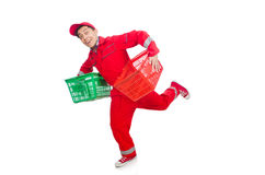 Man in red coveralls with shopping supermarket. Cart trolley Stock Photo