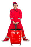 Man in red coveralls with shopping supermarket cart. Trolley Royalty Free Stock Images