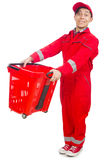 Man in red coveralls with shopping supermarket cart Stock Photography