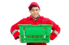 Man in red coveralls with shopping supermarket cart. Trolley Stock Photo