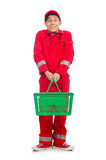 Man in red coveralls with shopping supermarket cart. Trolley Royalty Free Stock Image