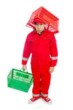 Man in red coveralls with shopping supermarket cart Stock Photos