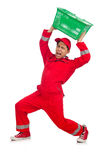 Man in red coveralls with shopping supermarket cart Stock Photo