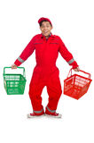 Man in red coveralls with shopping supermarket cart. Trolley Stock Photography