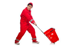 Man in red coveralls with shopping supermarket. Cart trolley Royalty Free Stock Photography