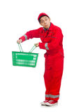 Man in red coveralls with shopping supermarket. Cart trolley Stock Images