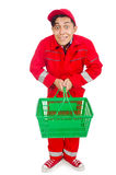 Man in red coveralls with shopping supermarket. Cart trolley Royalty Free Stock Photos