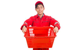 Man in red coveralls with shopping supermarket. Cart trolley Royalty Free Stock Images