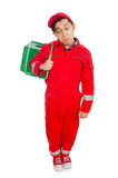 Man in red coveralls with shopping supermarket Royalty Free Stock Photography