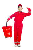 Man in red coveralls with shopping supermarket Stock Photo